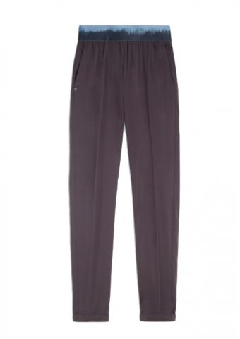 Trousers with dip dye effect elasticated waistband